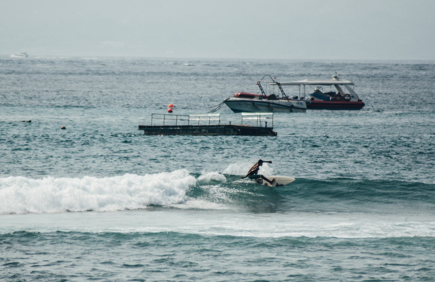 Surfing on Nusa Lembongan - The tiny island with crystal